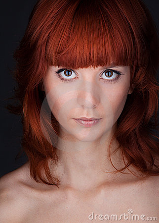 Woman with big eyes and red hair