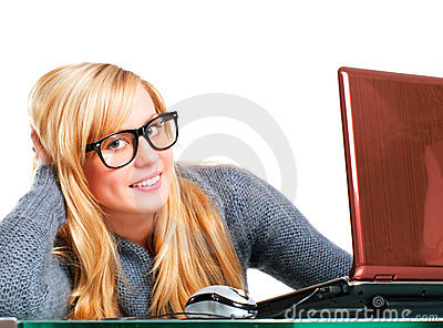 Woman in big glasses working on computer