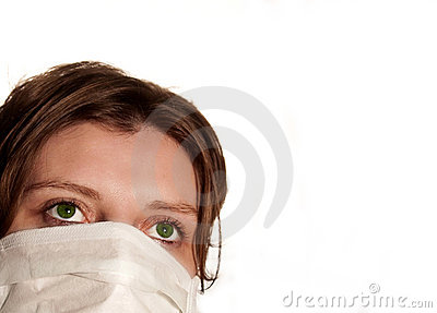 Woman with big green eyes wearing medical mask