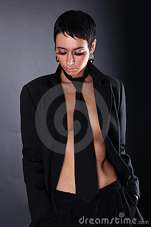 Woman in big man coat and tie