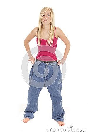 Woman big pants worried look