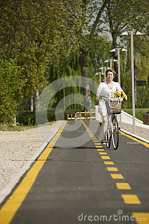 Woman with bike on the bikeway