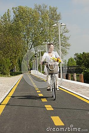 Woman with bike on the bikeway
