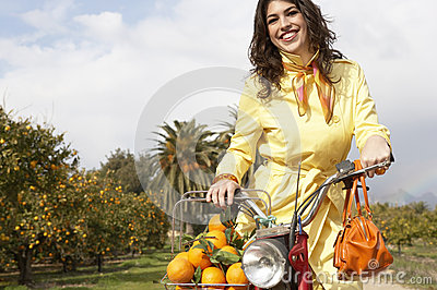 Woman on Bike with Oranges