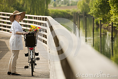 Woman with bike by river