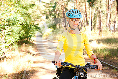 Woman  on the bike in the sunny