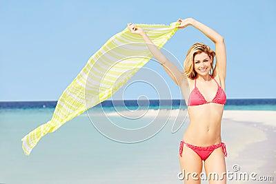 Woman In Bikini On Beautiful Tropical Beach Holding Sarong