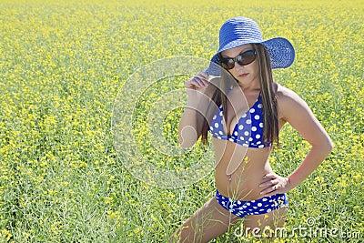 Woman in bikini canola field