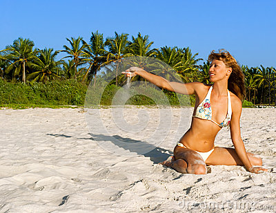 Woman in bikini enjoy on a tropical beach
