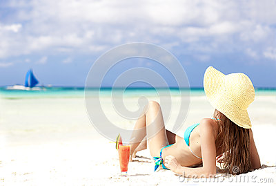 Woman in bikini with fresn watermelon juice on tropical beach