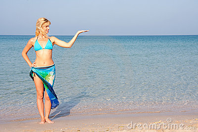 Woman in bikini presenting the sea vacation
