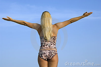 Woman in bikini with raised hands