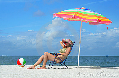 Woman in bikini tanning on the beach