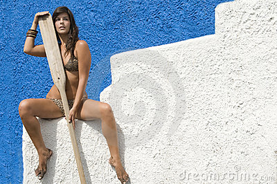 Woman in bikini waiting for her boat