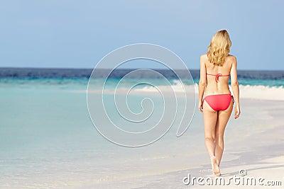 Woman In Bikini Walking On Beautiful Tropical Beach