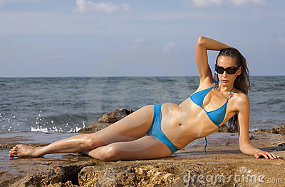 Woman in bikinis sunbathing