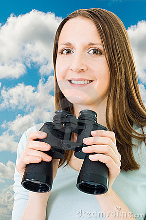 Woman with binocular and sky