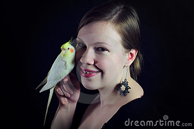 Woman with bird close friends