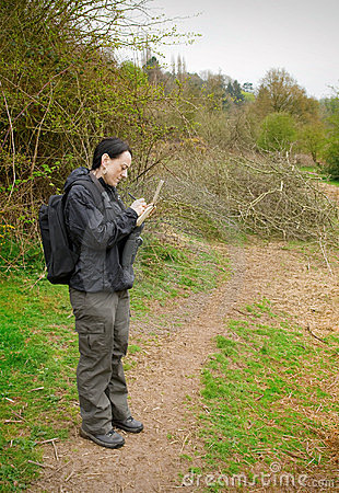 Woman birdwatching with notepad