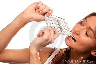 Woman bite the pack of medicine aspirin tablets