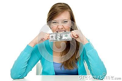 Woman biting dollar bill