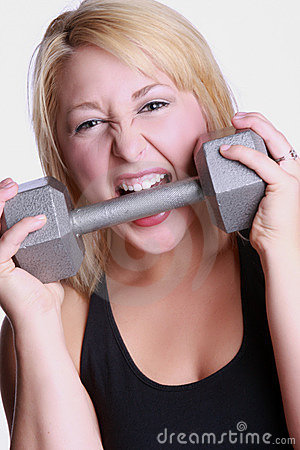 Woman biting dumbbell