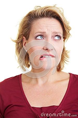 Woman biting on her lip