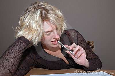 Woman biting pen