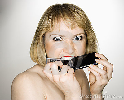 Woman biting phone.