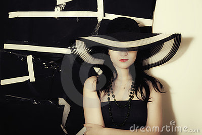 Woman on black background in summer hat