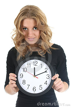 Woman in black with clock