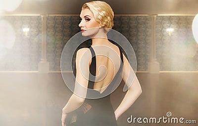 Woman in black dress indoors