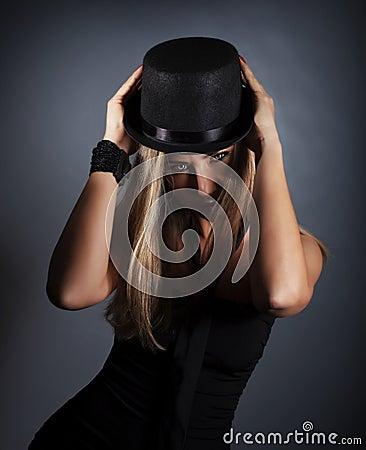 Woman in black hat