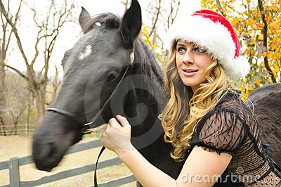Woman with a black horse