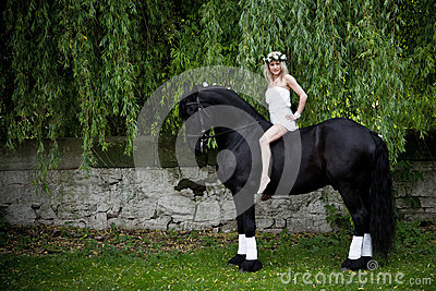 Woman on a black horse