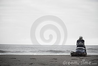 Woman In Black Jacket Sitting On Log At The Sea Under White Sky Free Public Domain Cc0 Image
