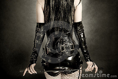 Woman in black latex corset
