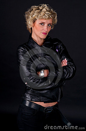 Woman in black leather fashion clothes