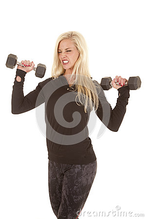 Woman in black lifting two weights