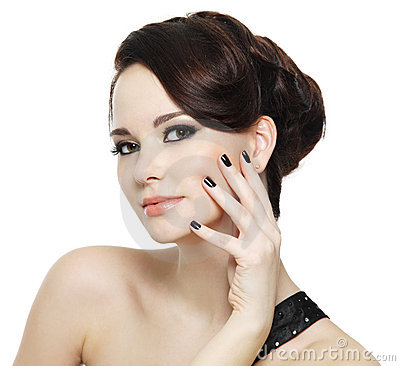 Woman with black nails and bright eye make-up
