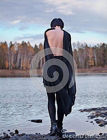 Woman in black near river