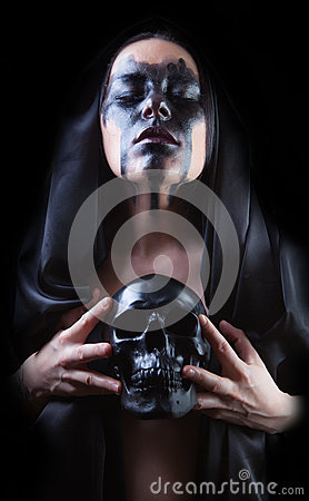 Woman in black with skull