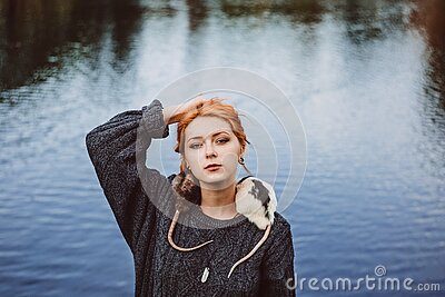 Woman In Black Sweater Standing Near Body Of Water During Daytime Free Public Domain Cc0 Image