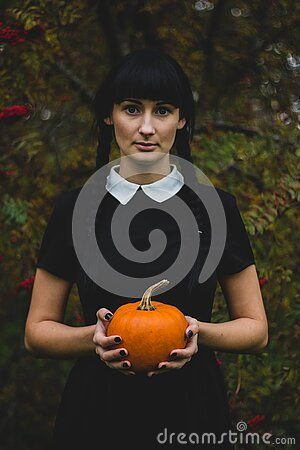 Woman In Black And White Collared Dress Holding Pumpkin During Daytime Free Public Domain Cc0 Image