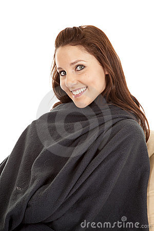 Woman in blanket with a smile