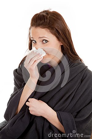 Woman in blanket with tissue