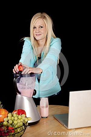 Woman with blender and strawberry