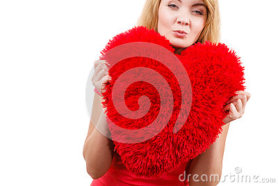 Woman blonde girl holding red heart love symbol Stock Photo