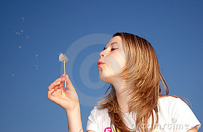 Woman blow a dandelion