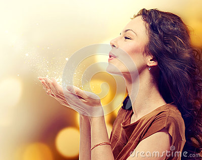 Woman Blowing Magic Dust
